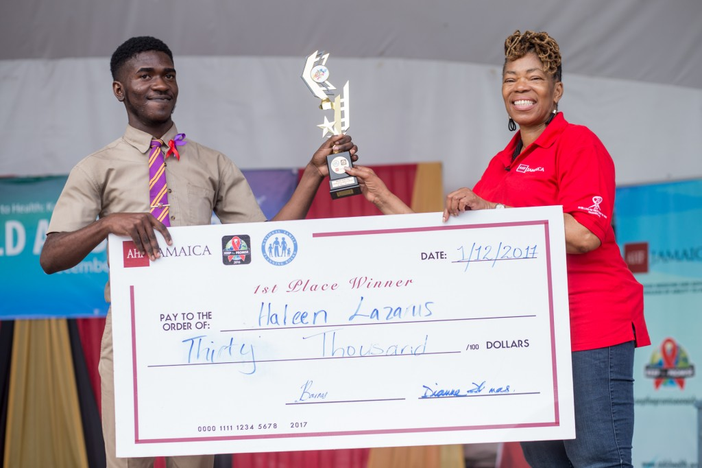 Haleem Lazarus receives prize cheque